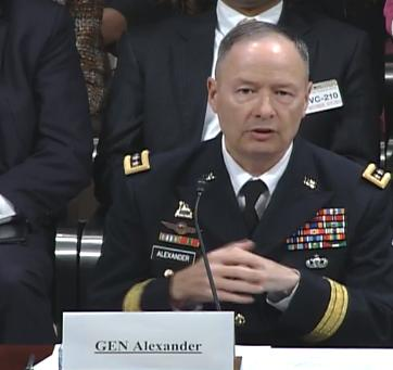 General Keith Alexander, director of the U.S. National Security Agency, defends his agency's surveillance programs before a House committee Tuesday.