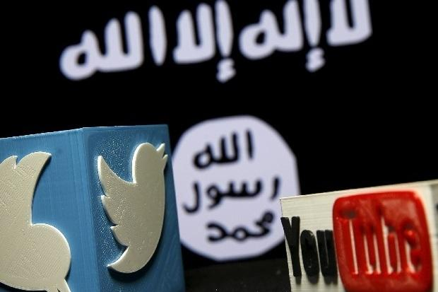 A 3D plastic representation of the Twitter and Youtube logo is seen in front of a displayed ISIS flag in this photo illustration in Zenica, Bosnia and Herzegovina. Credit: REUTERS/Dado Ruvic